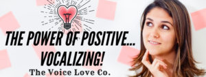 A girl looks at a lightbulb thoughtfully contemplating The Power of Positive Vocalizing. Think your way to a better voice. 3 ways how HERE at The Voice Love Co.