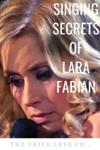 Lara Fabian sings into a mic. Singing Secrets of Lara Fabian HERE at The Voice Love Co. voicelove.co