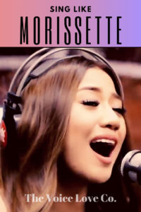 Morissette Amon sings into a microphone while wearing headphones. Sing Like Morissette via The Voice Love Co. HERE.