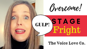 Voice Coach Christi Bovee looks frightened and GULPS! loudly. Overcome stage fright HERE at The Voice Love Co.